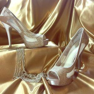 Gold Enzo Angiolini pumps. Small scuff on heel.
